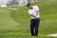 Bryson DeChambeau chips onto the second green during the second round of the U.S. Open Golf Championship, Friday, June 18, 2021, at Torrey Pines Golf Course in San Diego. (AP Photo/Marcio Jose Sanchez)