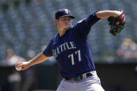 Seattle Mariners' Chris Flexen pitches against the Oakland Athletics during the first inning of a baseball game in Oakland, Calif., Tuesday, Aug. 24, 2021. (AP Photo/Jeff Chiu)