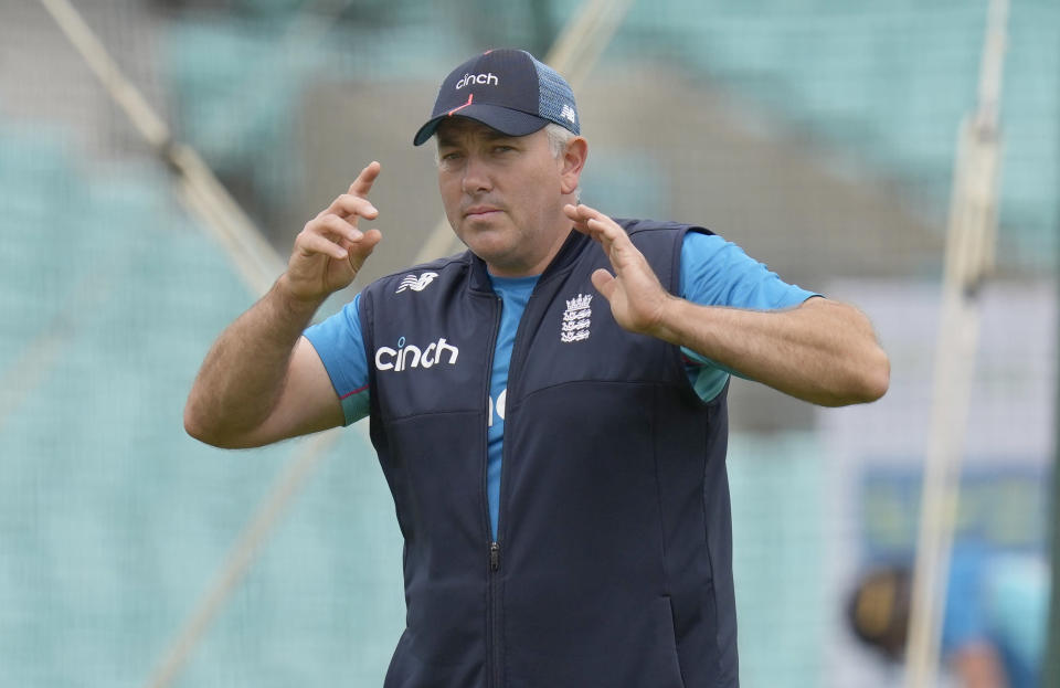 FILE - In this Sept. 1, 2021 file photo, England's head coach Chris Silverwood gestures as he speaks to players during a training session in London. England have named a 17-man squad for this winter's Ashes tour, with head coach Chris Silverwood leaning on familiar faces for the trip. Silverwood and captain Joe Root are unable to call on a full-strength group due to the continued hiatus of star all-rounder Ben Stokes and injuries to Jofra Archer, Olly Stone and Sam Curran but fears over players opting out due to concerns over Australia's travel restrictions have not materialized. (AP Photo/Kirsty Wigglesworth)