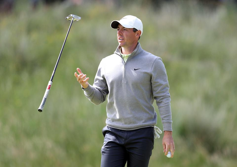 Rory McIlroy juggles his putter (PA Wire)