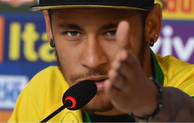Brazil's forward Neymar gives a press conference in Teresopolis on July 10, 2014, during the FIFA World Cup (AFP Photo/Vanderlei Almeida)