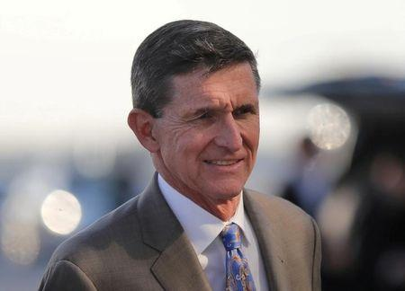 FILE PHOTO - U.S. National Security Advisor Michael Flynn boards Air Force One at West Palm Beach International airport in West Palm Beach