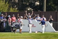Harris English, center, celebrates after hitting a hole-in-one on No. 15 during the first round of the Tour Championship golf tournament Thursday, Sept. 2, 2021, at East Lake Golf Club in Atlanta. (AP Photo/Brynn Anderson)