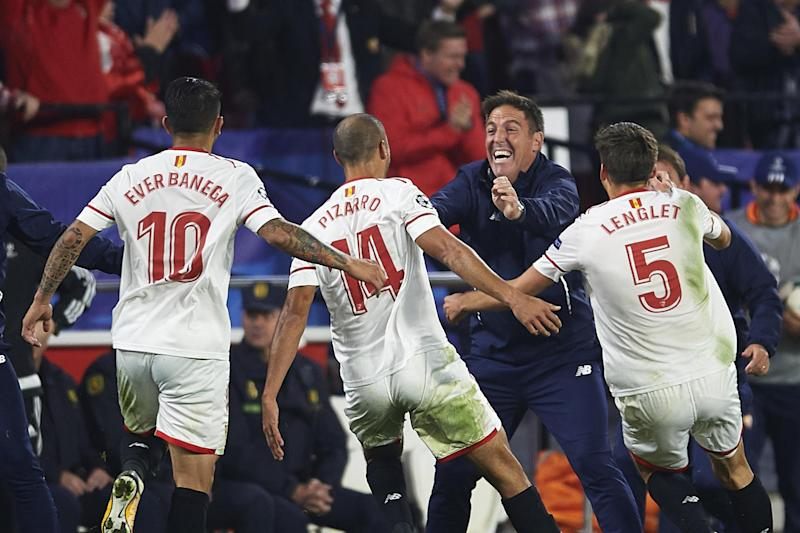 Sevilla players celebrate their late equaliser with head coach Berizzo: Getty Images
