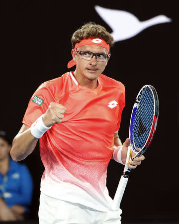 Tennis - Australian Open - First Round - Rod Laver Arena, Melbourne, Australia, January 14, 2019. Uzbekistan's Denis Istomin reacts during the match against Switzerland's Roger Federer. REUTERS/Kim Kyung-Hoon