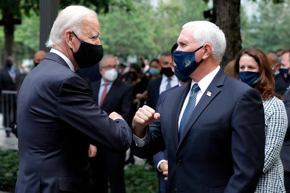 Joe Biden greets Vice President Mike Pence at the 19th anniversary ceremony marking the 9/11 attacks at the National September 11 Memorial & Museum in New York on Sept. 11, 2020.