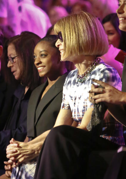 Olympic gold medalist gymnast Simone Biles, center, and Vogue editor-in-chief Anna Wintour, right, pose before seeing the Vera Wang Spring 2017 collection fashion show during Fashion Week, Tuesday Sept. 13, 2016, in New York. (AP Photo/Bebeto Matthews)