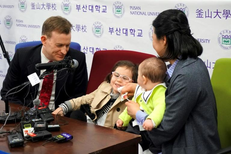 Professor Robert Kelly (L), who became an internet hit after his children crashed a live BBC interview, attended a press conference on March 15, 2017 with his wife Kim Jung-A (R), daughter Marion (2nd L) and toddler son James (2nd R)