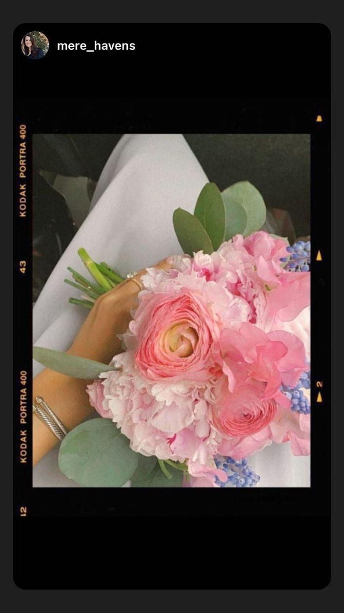 <p>One of Alex's bridesmaids snapped a sneak peek at her bouquet.</p>