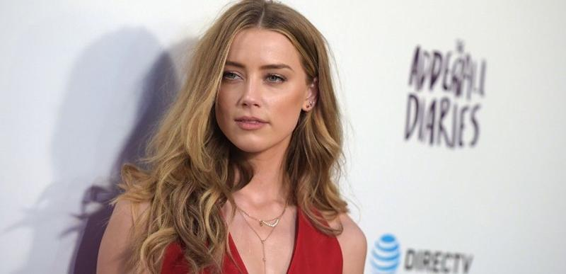 Amber Heard poses at an event
