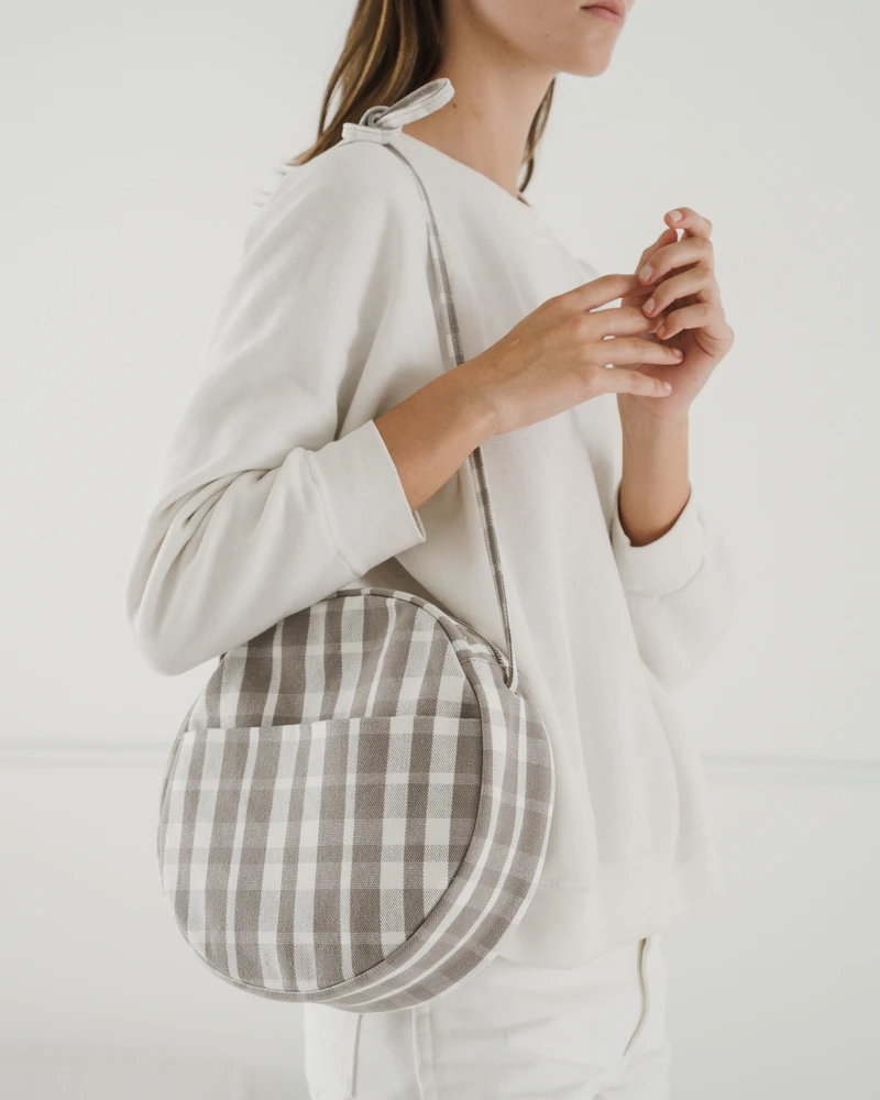"""<h2>Baggu</h2><br><strong>Sale:</strong> The Baggu sale section is teaming with deals on all kinds of bags and backpacks.<br><strong>Dates:</strong> Limited-time<br><strong>Promo Code: </strong>None<br><br><em>Shop <strong><a href=""""https://baggu.com/collections/category-sale"""" rel=""""nofollow noopener"""" target=""""_blank"""" data-ylk=""""slk:Baggu"""" class=""""link rapid-noclick-resp"""">Baggu</a></strong></em><br><br><strong>Baggu</strong> Medium Canvas Circle Purse, $, available at <a href=""""https://go.skimresources.com/?id=30283X879131&url=https%3A%2F%2Fbaggu.com%2Fcollections%2Fcategory-sale%2Fproducts%2Fmedium-canvas-circle-purse-dove-plaid"""" rel=""""nofollow noopener"""" target=""""_blank"""" data-ylk=""""slk:Baggu"""" class=""""link rapid-noclick-resp"""">Baggu</a>"""