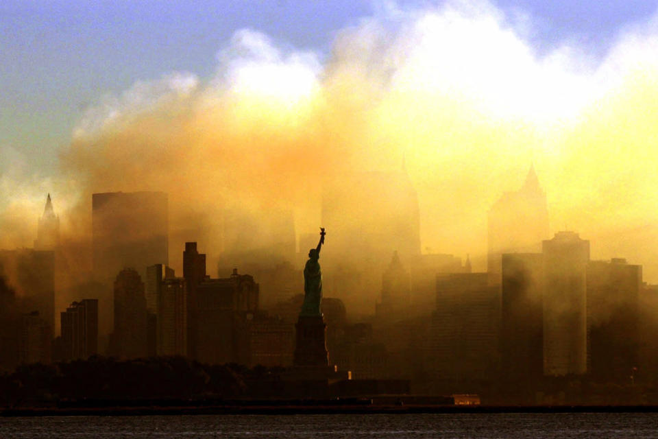 FILE - In this Saturday, Sept. 15, 2001 file photo, the Statue of Liberty stands in front of a smoldering lower Manhattan at dawn, seen from Jersey City, N.J. The Sept. 11, 2001 terrorist attacks on the United States nearly 20 years ago precipitated profound changes in America and the world. (AP Photo/Dan Loh, File)