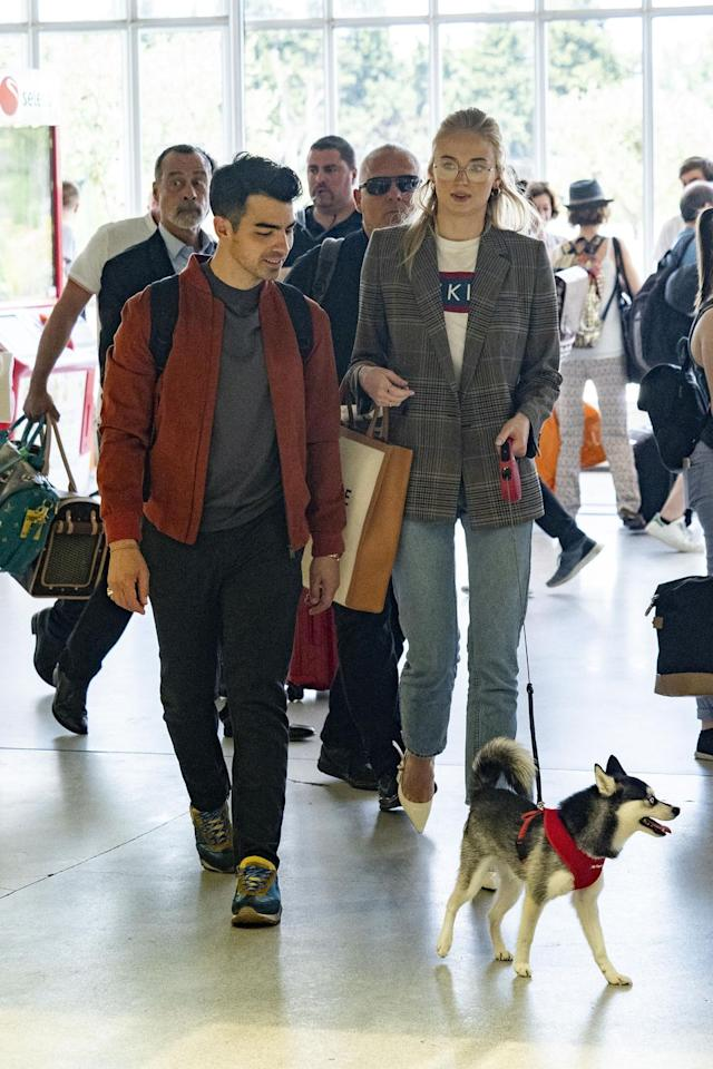 <p>Ahead of their rehearsal dinner and second wedding, Turner and Jonas arrived at Avignon Provence Airport with their husky pup, Porky Basquiat. </p>
