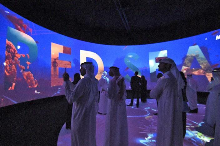 Participants watch a film advertising Saudi Arabia's Red Sea project on the sidelines of the Future Investment Initiatives conference in Riyadh on October 25, 2017 (AFP Photo/FAYEZ NURELDINE)