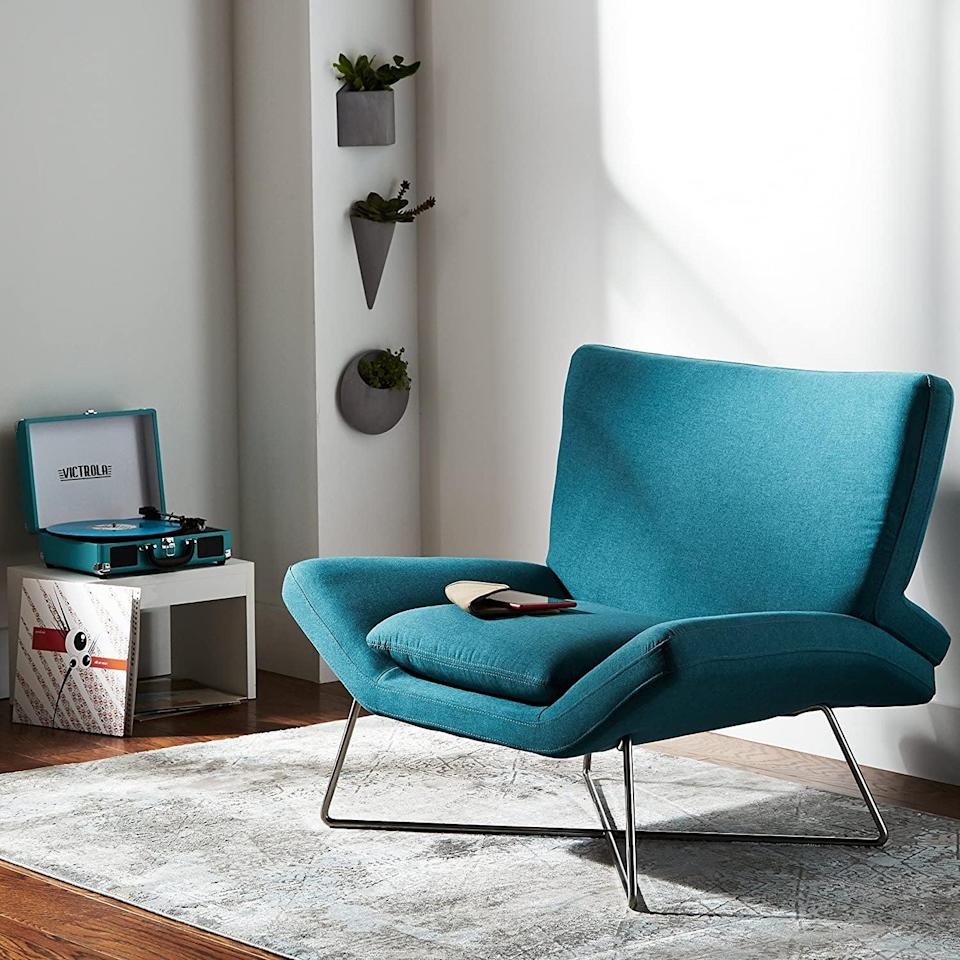 <p>The sleek, modern look of this <span>Rivet Farr Lotus Accent Chair</span> ($521, originally $564) sold us.</p>