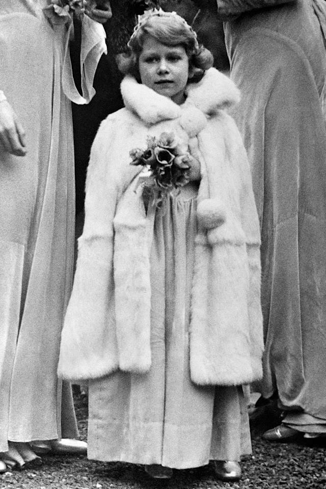 "<p>Five-year-old Princess Elizabeth (her coronation as Queen happened in 1953) <a rel=""nofollow"" href=""https://www.goodhousekeeping.com/life/relationships/g3126/vintage-bridesmaid-dresses/"">serving as a bridesmaid</a> at the wedding of Lady May Cambridge and Captain Henry Abel Smith.</p>"