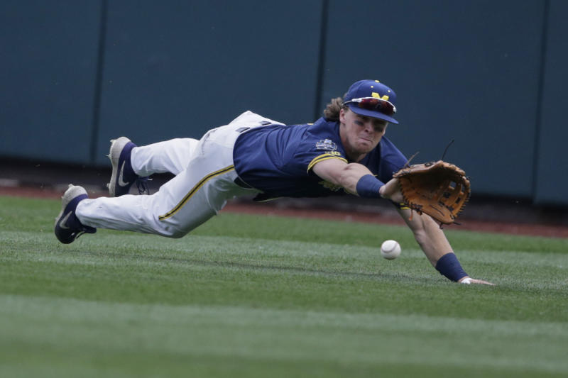Michigan center fielder Jesse Franklin leaps for but misses a ball hit by Florida State's Mike Salvatore for a double in the first inning of an NCAA College World Series baseball game in Omaha, Neb., Monday, June 17, 2019. (AP Photo/Nati Harnik)