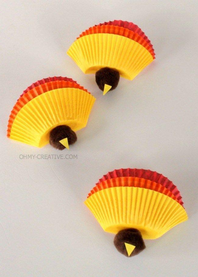 "<p>A few baking cups, some brown craft pom-poms, and a spot of glue is all it takes to bring this adorable idea to life. You can cut the yellow beak out of the bottom of the yellow cups.</p><p><strong>Get the tutorial at <a href=""https://www.ohmy-creative.com/holiday-crafts/thanksgiving/kids-thanksgiving-turkey-craft/"" target=""_blank"">Oh My Creative</a>. </strong></p><p><strong><a class=""body-btn-link"" href=""https://www.amazon.com/Yellow-Glassine-Baking-Liners-Cupcake/dp/B00CV62HZ2?tag=syn-yahoo-20&ascsubtag=%5Bartid%7C10050.g.22626432%5Bsrc%7Cyahoo-us"" target=""_blank"">SHOP CUPCAKE LINERS</a></strong></p>"