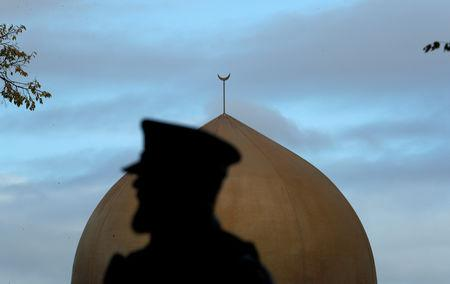 A police officer is pictured outside Masjid Al Noor mosque in Christchurch, New Zealand, March 17, 2019. REUTERS/Jorge Silva