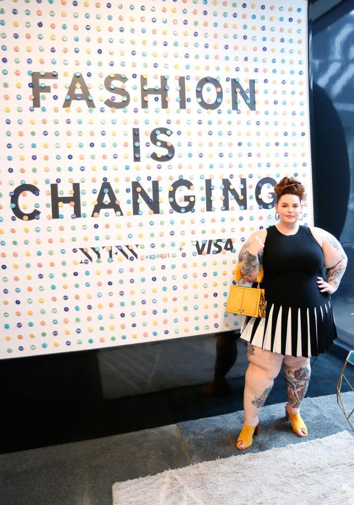 """<p>Tess Holliday wears a Milly dress from <a rel=""""nofollow noopener"""" href=""""https://11honore.com/products/milly-black-white-pleated-contrast-mermaid-dress"""" target=""""_blank"""" data-ylk=""""slk:11 Honoré"""" class=""""link rapid-noclick-resp"""">11 Honoré</a> during New York Fashion Week at Spring Studios on September 7, 2018 in New York City. (Photo: Getty) </p>"""