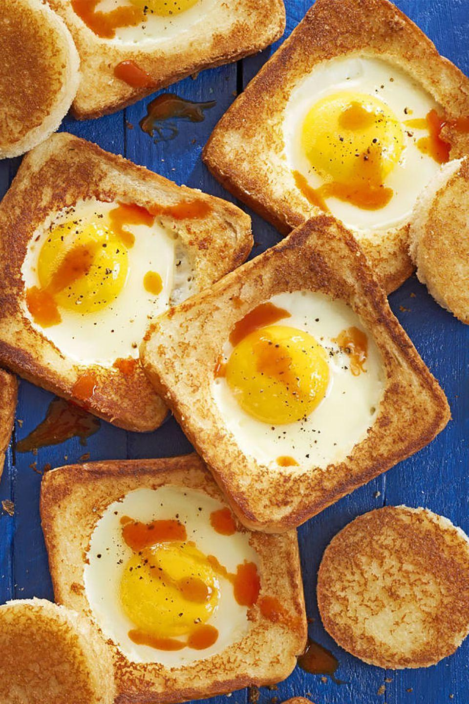 "Upgrade his toast by cooking it on the stove with the classic egg-in-a-hole method, then add some Parmesan cheese and hot sauce for an added kick. <a href=""https://www.countryliving.com/food-drinks/recipes/a41630/parmesan-egg-in-hole-recipe/"" rel=""nofollow noopener"" target=""_blank"" data-ylk=""slk:Get the recipe."" class=""link rapid-noclick-resp""><strong>Get the recipe.</strong></a> <a href=""https://www.amazon.com/CybrTrayd-RM-1728-Biscuit-Cutter-Metallic/dp/B005G87J7I?tag=syn-yahoo-20&ascsubtag=%5Bartid%7C10050.g.4356%5Bsrc%7Cyahoo-us"" class=""link rapid-noclick-resp"" rel=""nofollow noopener"" target=""_blank"" data-ylk=""slk:SHOP BISCUIT CUTTERS"">SHOP BISCUIT CUTTERS</a>"