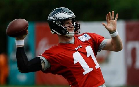 Philadelphia Eagles' quarterback Carson Wentz throws during practice at the team's NFL football training facility in Philadelphia - Credit: AP Photo/Matt Rourke