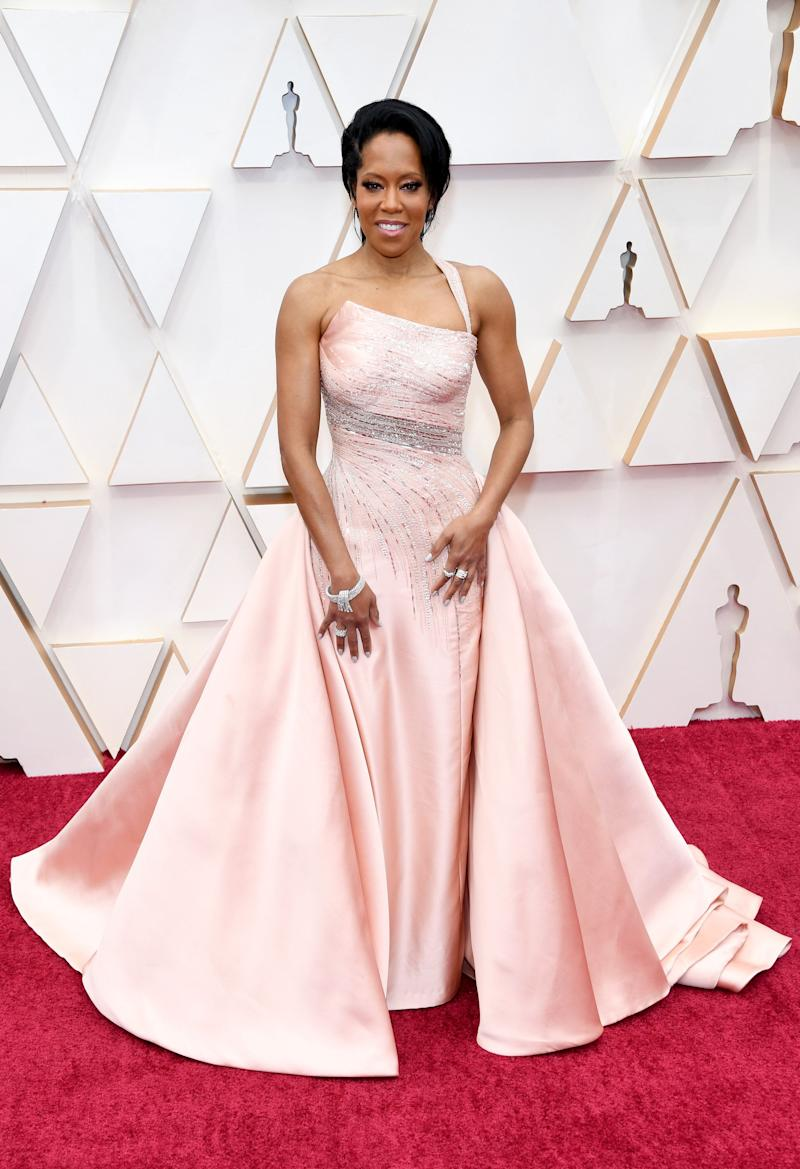 """This Versace dress is one of the best of the night: the muted rose colour is restrained, but the diamonds are glam. The cut and the train are both so elegant. """"It'sthe first time I've had this much dress,"""" she told E! on the red carpet, but it's definitely working."""