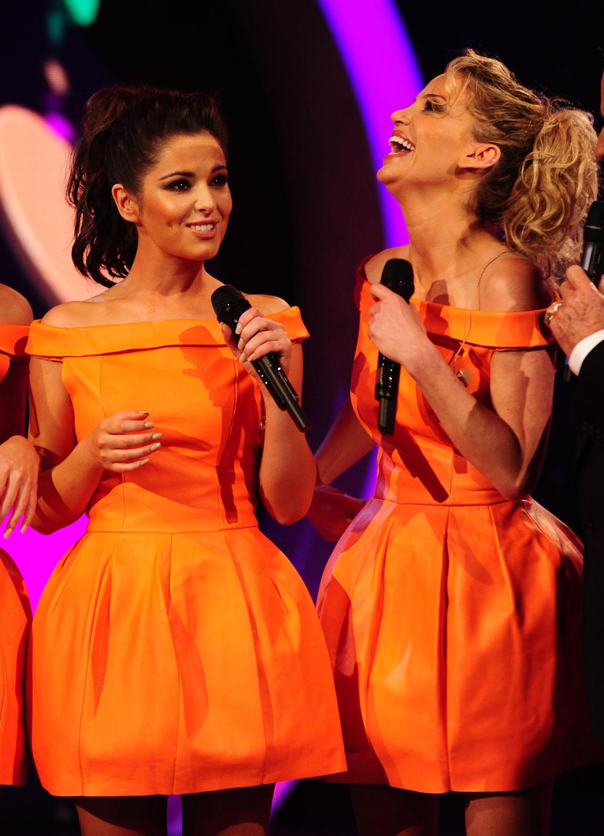 Cheryl Cole and Sarah Harding of girlband Girls Aloud live on stage live during BBC Children In Need, London.   (Photo by Ian West/PA Images via Getty Images)
