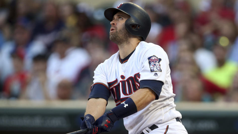 Minnesota Twins' Brian Dozier bats against the Kansas City Royals'in the first inning of a baseball game Tuesday, July 10, 2018, in Minneapolis. (AP Photo/Jim Mone)