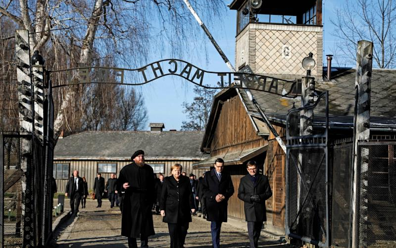 Angela Merkel is the third postwar German leader to visit Auschwitz - AP
