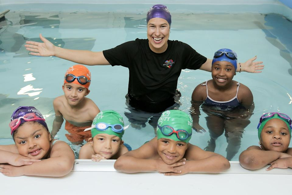 <p>In this together: Sarraounia Samuels with children from North Kensington she is teaching to swim. Ms Samuels set up her lessons in the aftermath of the Grenfell tragedy</p> (Matt Writtle)