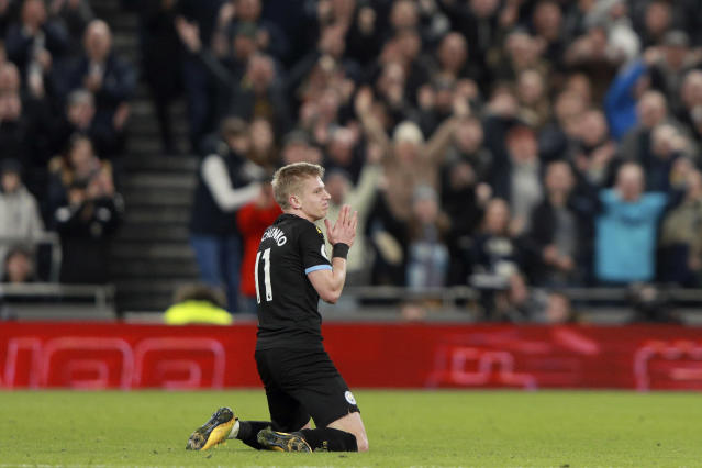 Manchester City's Oleksandr Zinchenko reacts after committing a second yellow card foul during the English Premier League soccer match between Tottenham Hotspur and Manchester City at the Tottenham Hotspur Stadium in London, England, Sunday, Feb. 2, 2020. (AP Photo/Ian Walton)