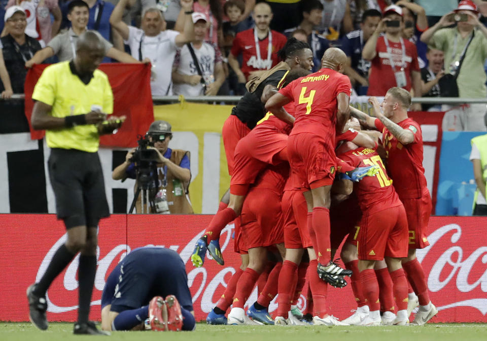 Belgium's team celebrates Nacer Chadli after he scored the decisive final goal during the round of 16 match between Belgium and Japan at the 2018 soccer World Cup in the Rostov Arena, in Rostov-on-Don, Russia, Monday, July 2, 2018. (AP Photo/Petr David Josek)
