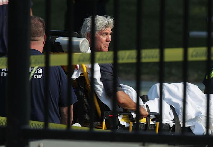 <p>U.S. Rep. Roger Williams is wheeled away by emergency medical service personnel from the Eugene Simpson Stadium Park June 14, 2017 in Alexandria, Va. (Photo: Alex Wong/Getty Images) </p>