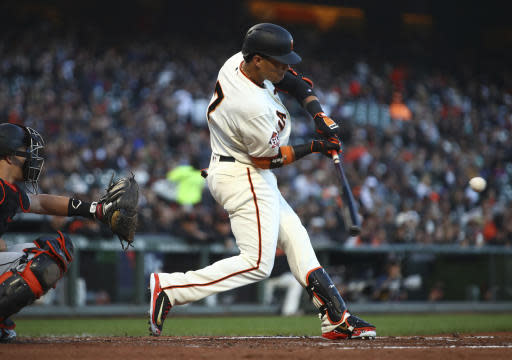 San Francisco Giants' Gorkys Hernandez swings for a two-run home run off Miami Marlins' Dan Straily during the second inning of a baseball game Tuesday, June 19, 2018, in San Francisco. (AP Photo/Ben Margot)