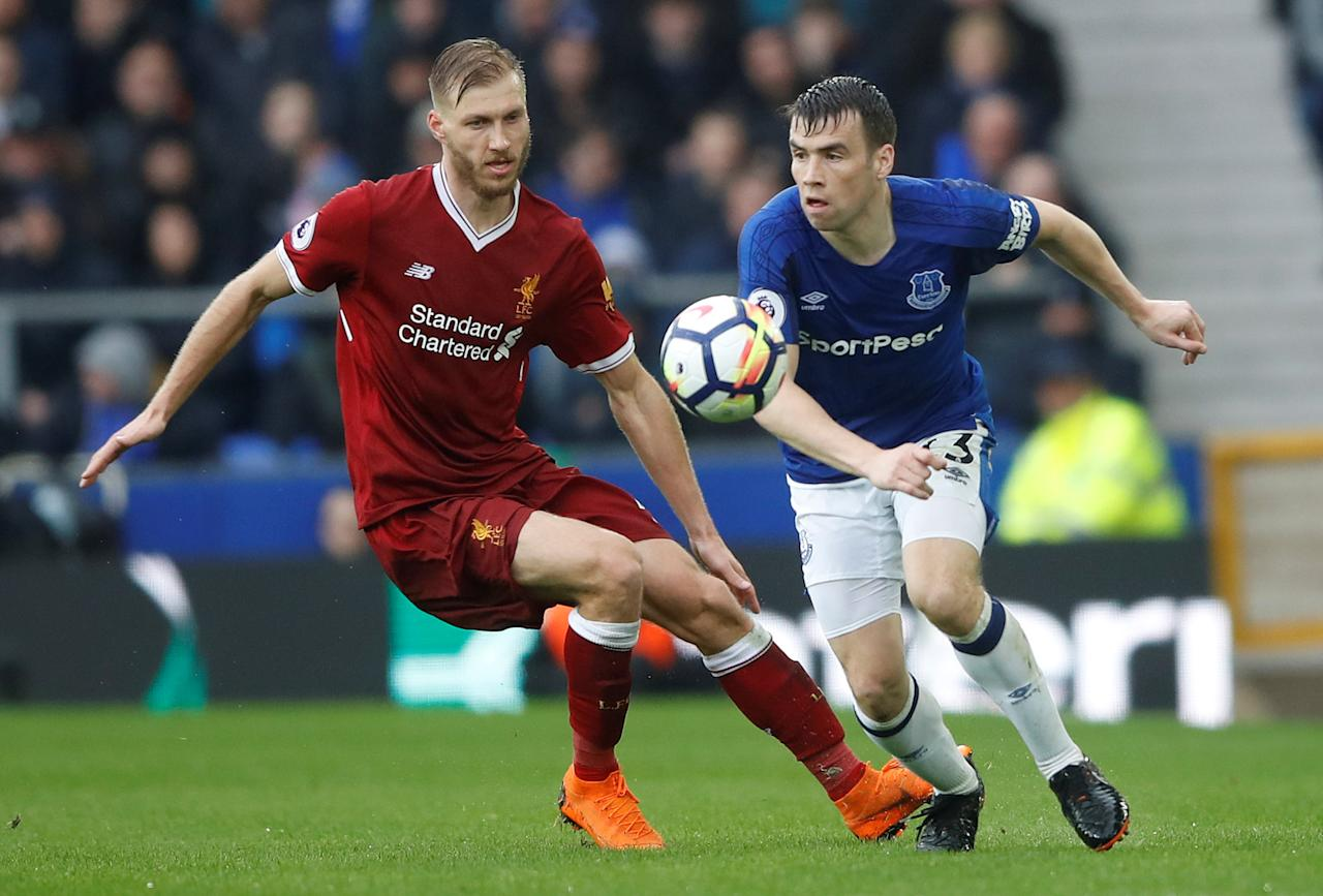 <p>Everton's Seamus Coleman keeps an eye on Liverpool's Ragnar Klavan </p>