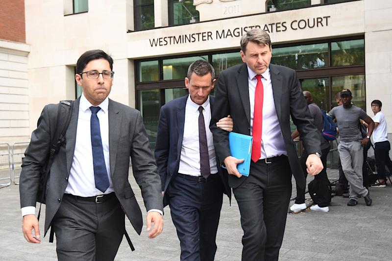 Lord Holmes of Richmond (centre) leaving Westminster Magistrates' Court, London where he appeared on charges of sexual assault