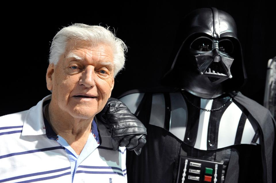 English actor David Prowse (L), who played the character of Darth Vader (Dark Vador in French) in the first Star Wars trilogy poses with a fan dressed up in a Darth Vader costume during a Star Wars convention on April 27, 2013 in Cusset.        AFP PHOTO THIERRY ZOCCOLAN        (Photo credit should read THIERRY ZOCCOLAN/AFP via Getty Images) (Photo: THIERRY ZOCCOLAN via Getty Images)