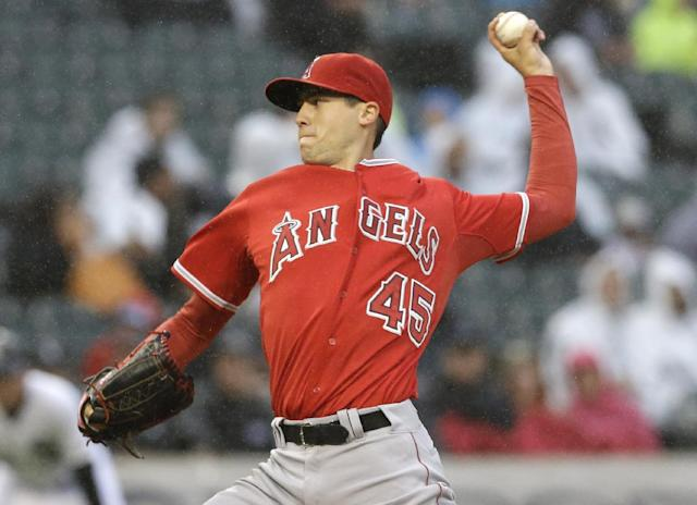 Los Angeles Angels starter Tyler Skaggs throws against the Chicago White Sox during the first inning of a baseball game in Chicago on Wednesday, July 2, 2014. (AP Photo/Nam Y. Huh)