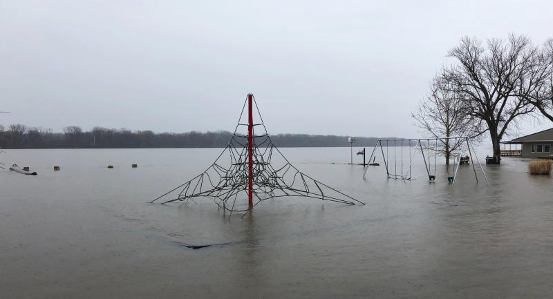 In this April 5, 2019, photo, a playground is submerged in floodwaters in Clarksville, Mo. Clarksville is recovering from its seventh major flood in a decade. Once again, a wall made of sandbags and rocks was hurriedly built to protect the quaint downtown, but with potentially worse flooding still to come this spring, Clarksville could face more danger. (AP Photo/Jim Salter)