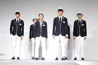 <p>What's the most notable thing about the dark blue jackets, white pants, and striped socks the South Korean team is wearing? The entire outfit has been infused with insect repellant, so the athletes won't have to worry about getting the Zika virus. <i>(Photo: Getty Images)</i><br></p>