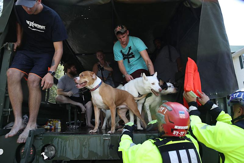 Tyler Bates holds his dogs as he is evacuated from his apartment by members of New York Urban Search and Rescue Task Force One due to flood waters from the Little River as it crests from the rains caused by Hurricane Florence as it passed through the area on September 18, 2018 in Spring Lake, North Carolina.