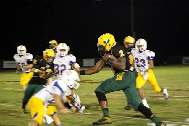 Derrick Henry has been abusing would-be tacklers with his vicious stiff arm since his days at Yulee High School, where he rushed for more than 12,000 yards and 153 touchdowns. (Courtesy of Cole Willis)