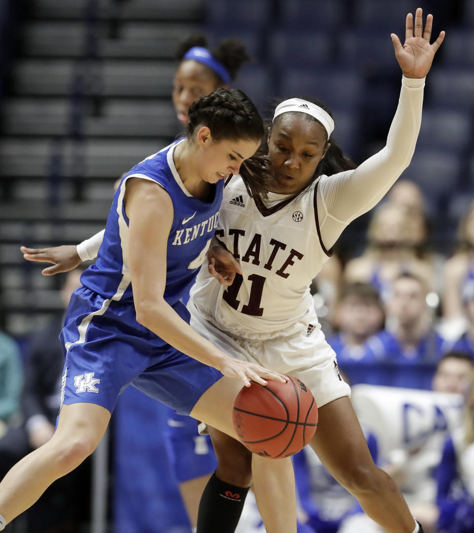 Kentucky guard Maci Morris (4) drives against Mississippi State guard Roshunda Johnson (11) in the second half of an NCAA college basketball game at the women's Southeastern Conference tournament Friday, March 2, 2018, in Nashville, Tenn. Mississippi State won 81-58. (AP Photo/Mark Humphrey)