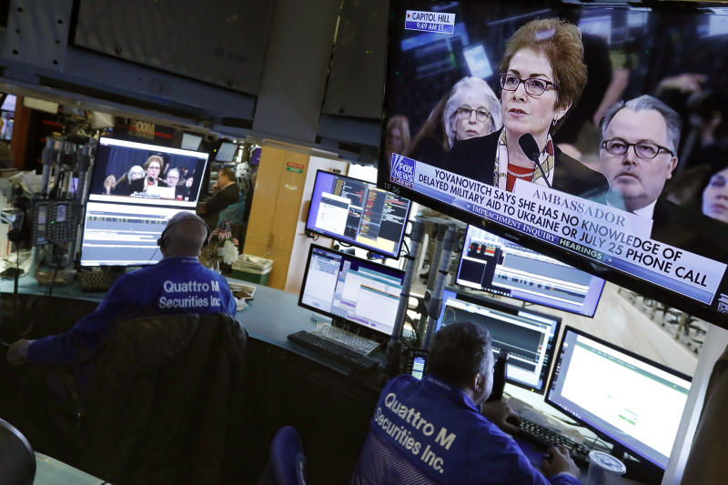 Former U.S. Ukraine Ambassador Marie Yovanovitch appears on televisions on the floor of the New York Stock Exchange, Friday, Nov. 15, 2019. Stocks are opening broadly higher on Wall Street as hopes continued to grow that the U.S. and China were moving closer to a deal on trade. (AP Photo/Richard Drew)