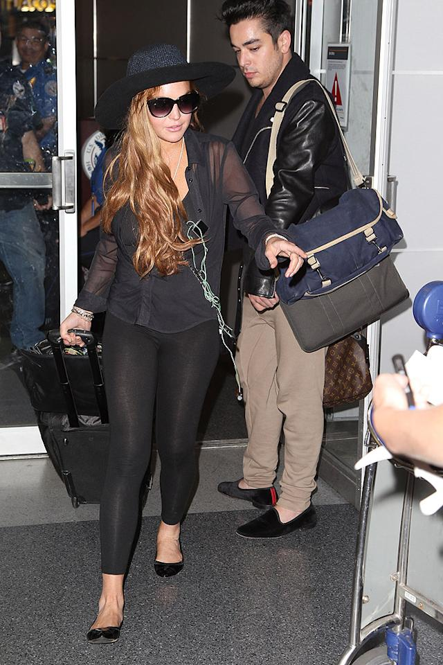 After being questioned by authorities in Los Angeles on Monday regarding a burglary at a house party she attended, Lindsay Lohan flew the coup and headed to New York for business meetings and family time -- but not before she was informed that she was not a suspect in the theft. (8/21/2012)