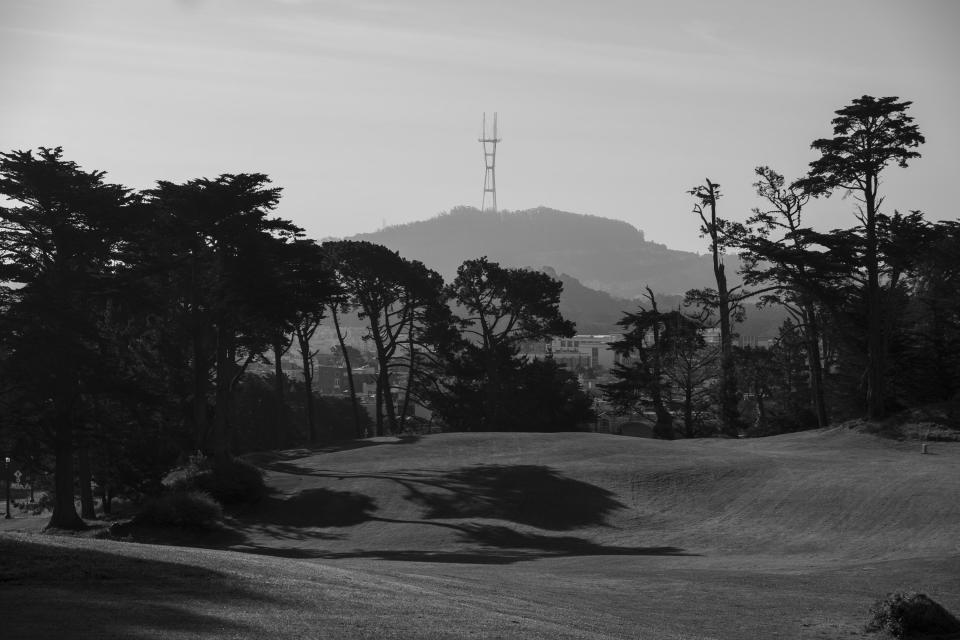 Shadows from cypress trees fall on the empty Lincoln Park Golf Course with Sutro Tower in the background in San Francisco on May 1, 2020. Normally, the months leading into summer bring bustling crowds to the city's famous landmarks, but this year, because of the coronavirus threat they sit empty and quiet. Some parts are like eerie ghost towns or stark scenes from a science fiction movie. (AP Photo/Eric Risberg)