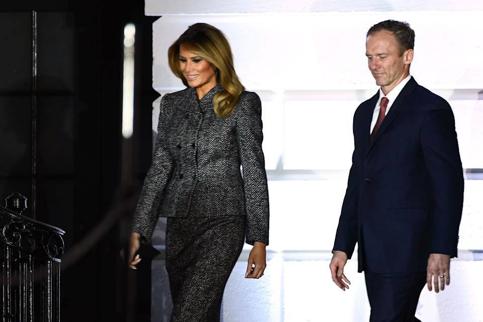 First lady Melania Trump arrives with Jesse Barrett, husband of Justice Amy Coney Barrett, for her swearing-in ceremony as a Supreme Court associate justice, on the South Lawn of the White House, Oct. 26, 2020.