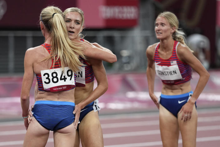 Courtney Frerichs, left, of the United States, is congratulated by teammates Emma Coburn, and Valerie Constien, right, after the final of the women's 3,000-meters steeplechase at the 2020 Summer Olympics, Wednesday, Aug. 4, 2021, in Tokyo. (AP Photo/Matthias Schrader)