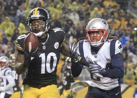 Dec 17, 2017; Pittsburgh, PA, USA; Pittsburgh Steelers wide receiver Martavis Bryant (10) catches a touchdown pass behind New England Patriots cornerback Stephon Gilmore (24) during the second quarter at Heinz Field. Mandatory Credit: Charles LeClaire-USA TODAY Sports